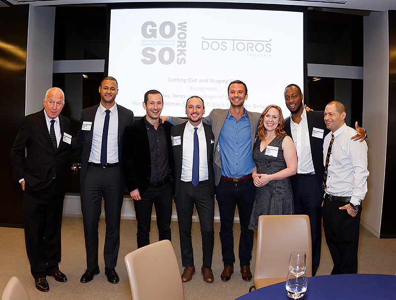 Getting Out / Staying Out (GOSO) honors Dos Toros Taqueria as Employer of the Year at a ceremony hosted by Goldman Sachs' IMD Black Employee Network, New York City December 6th, 2016. Left is GOSO founder Mark Goldsmith and GOSO Board President Reginald Andre and Dos Tores founders and employees with Geoffrey Golla of GOSO in the middle.