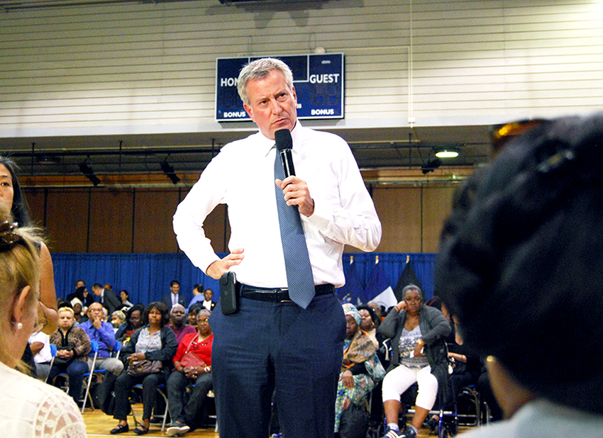 Mayor Bill de Blasio speaks to residents at his East Harlem Town Hall