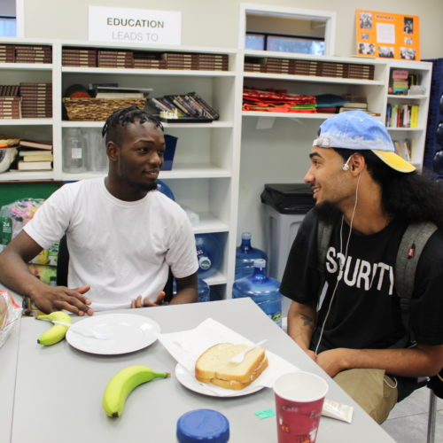 GOSO participants catching up over a sandwich and fruit in the kitchen!